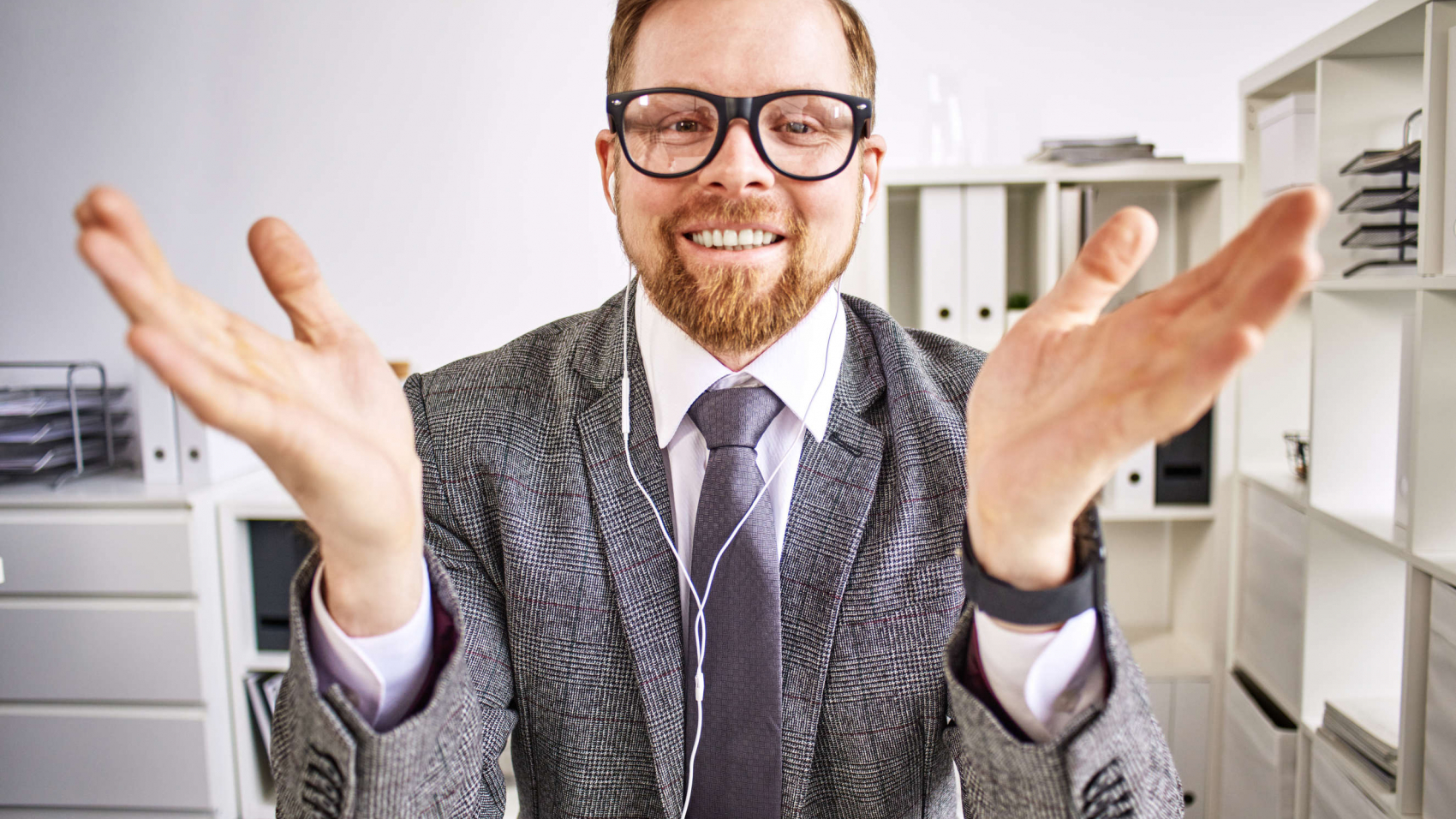 Businessman is happy about how his conference call ended.