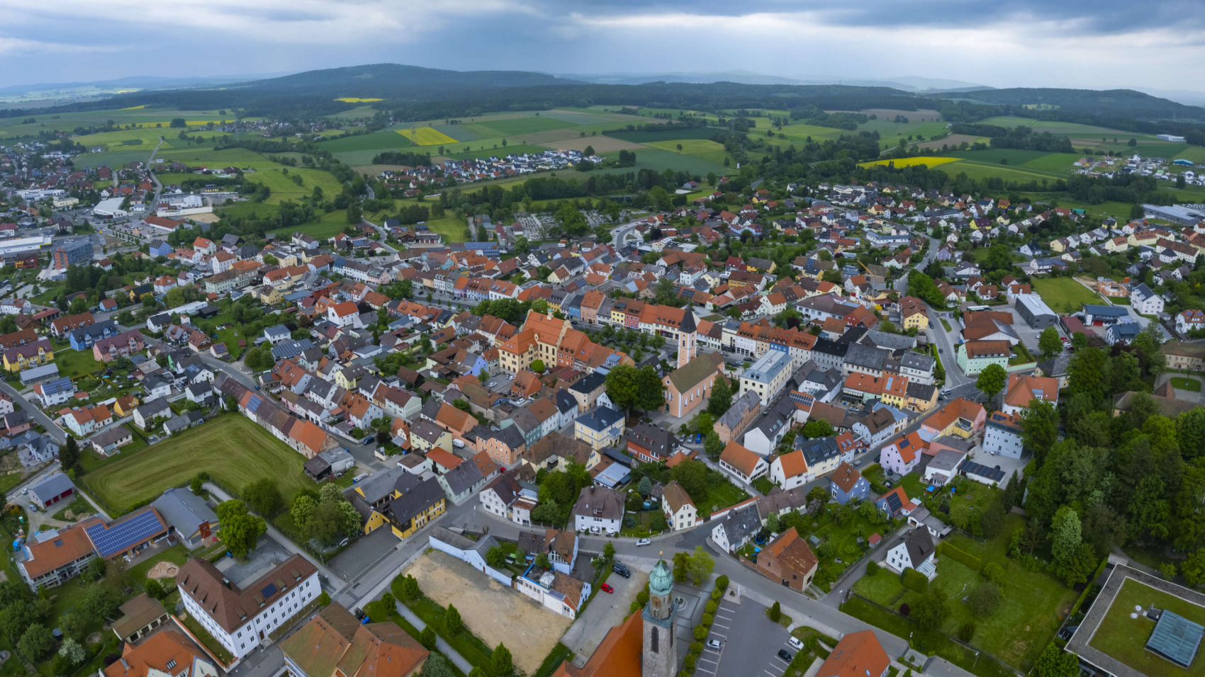 Aerial view of the city Vohenstrauß in Germany, on a cloudy day in spring.